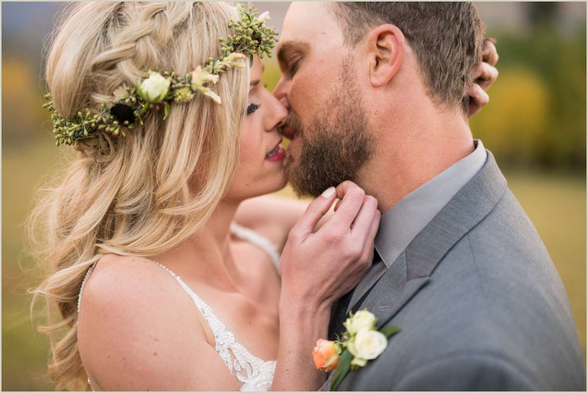 romantic kissing photo of bride and groom
