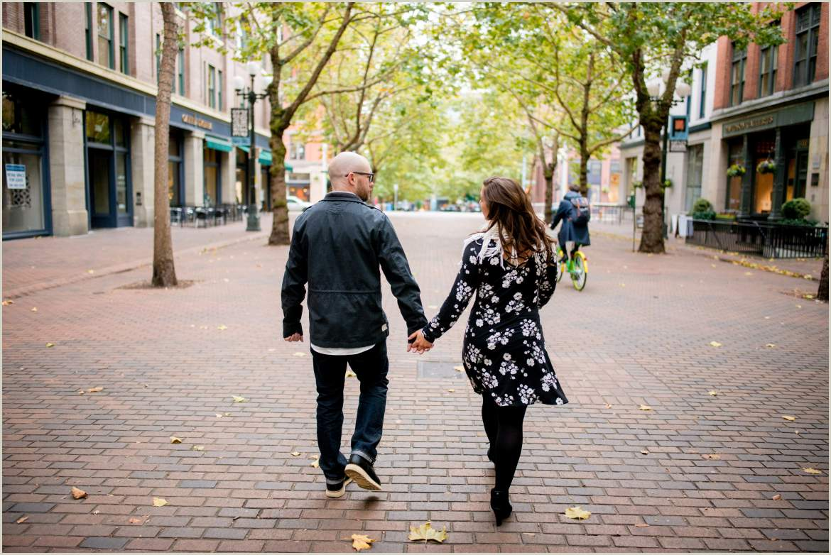 couple walking down street lifestyle photos