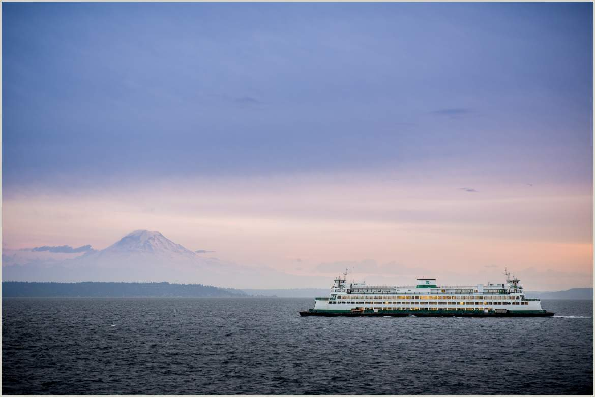 seattle ferry with mount rainier in background at sunset