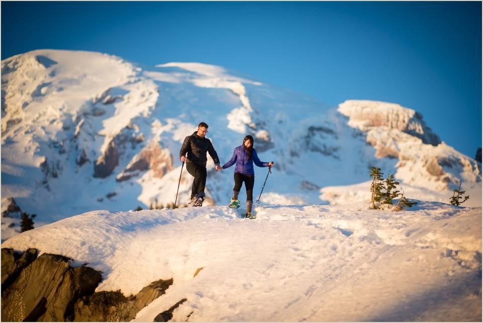adventurous couple snowshoes at mount rainier