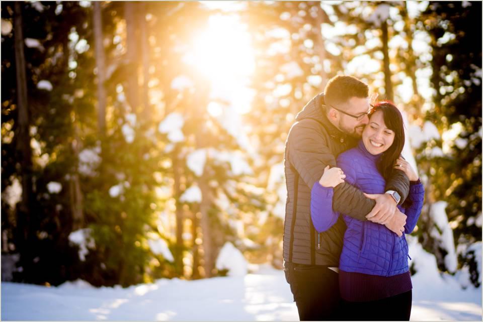 adventurous couples photos in the snow