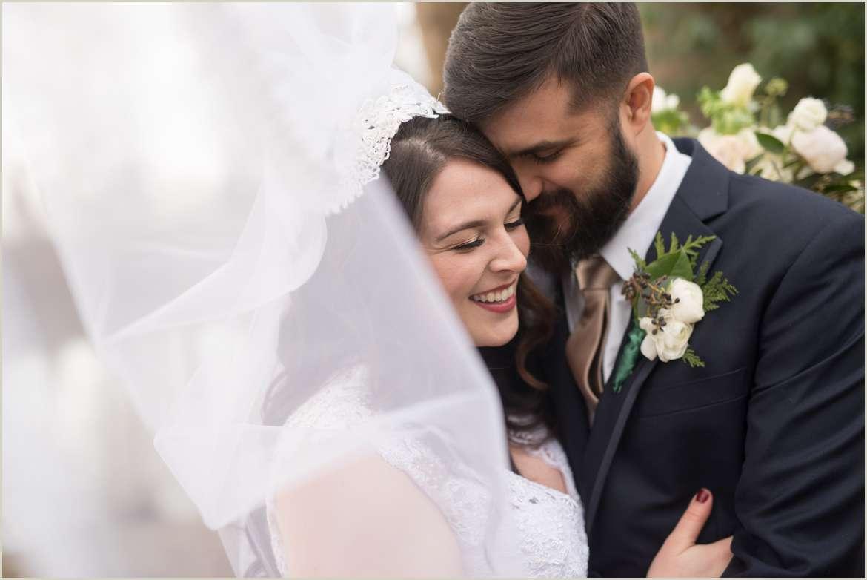 bride and groom photos with veil