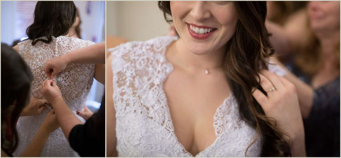 bride putting lace dress on