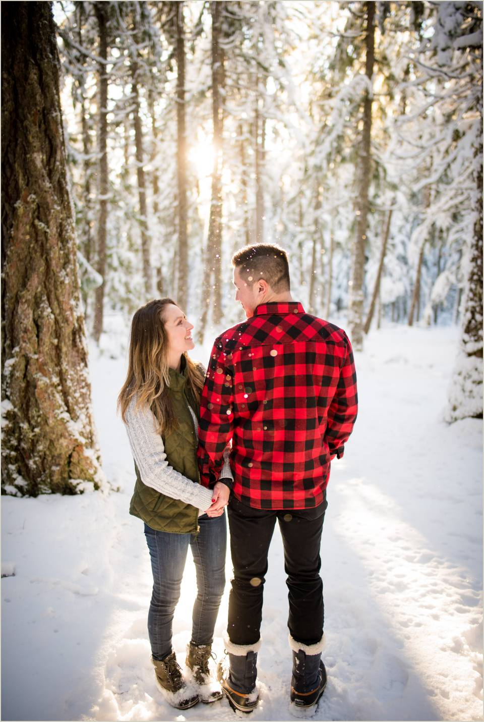couple holding hands winter engagement photos