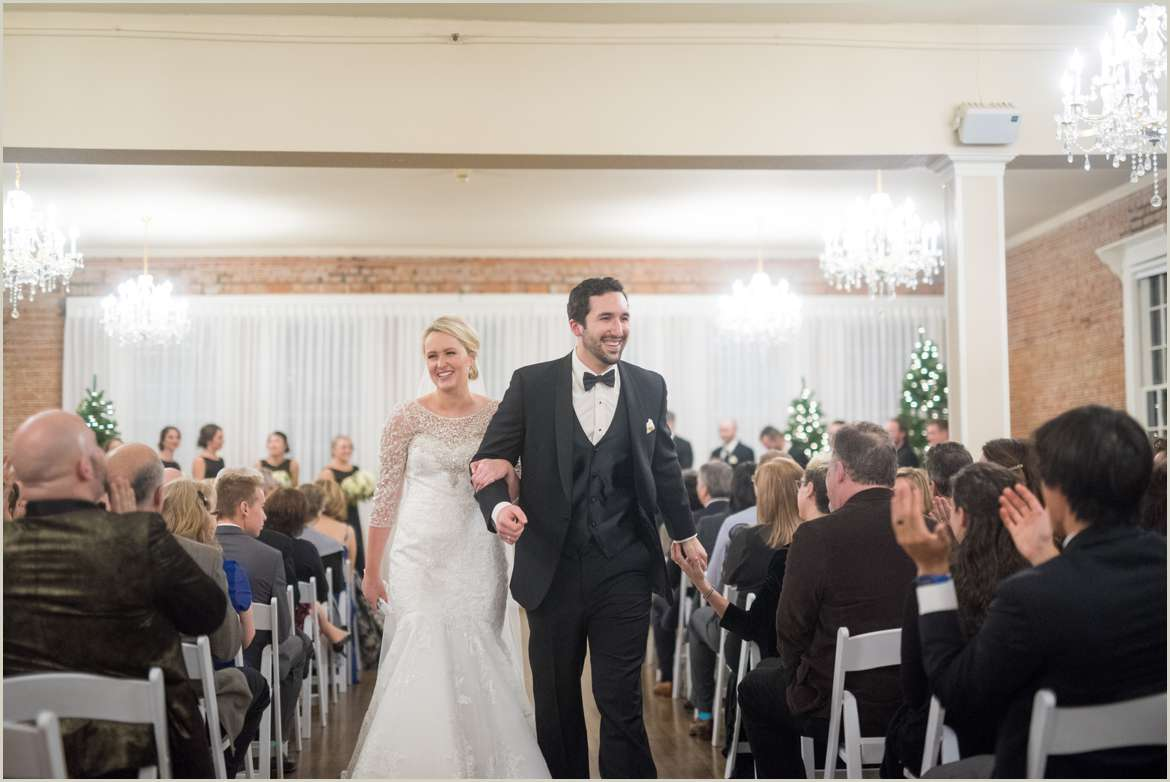 couple walking down aisle together 1