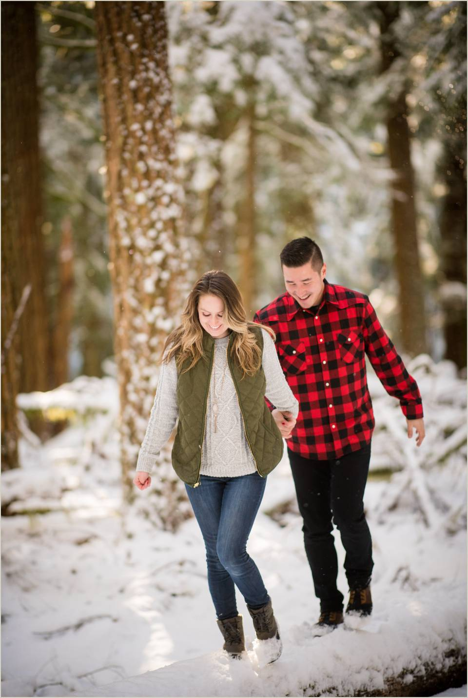 couple walking in snow engagemet session