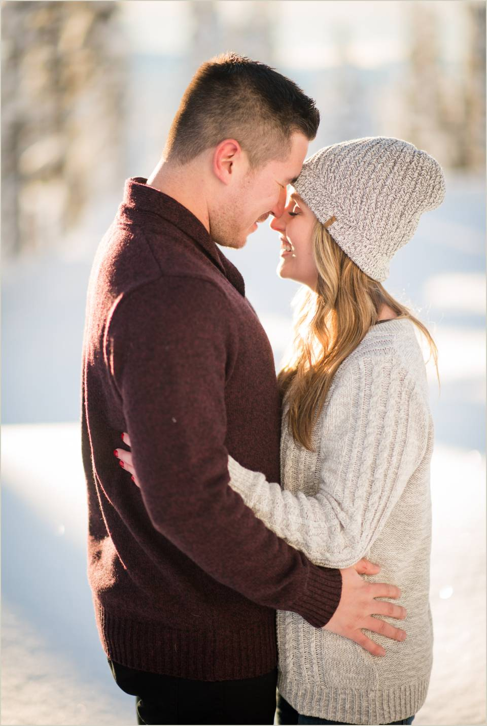 embracing warm winter engagement photos