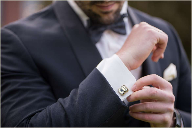 groom adjusting cuff links 1
