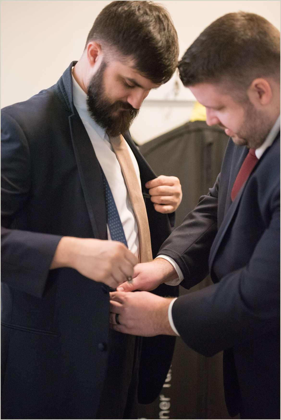 groom getting dresses