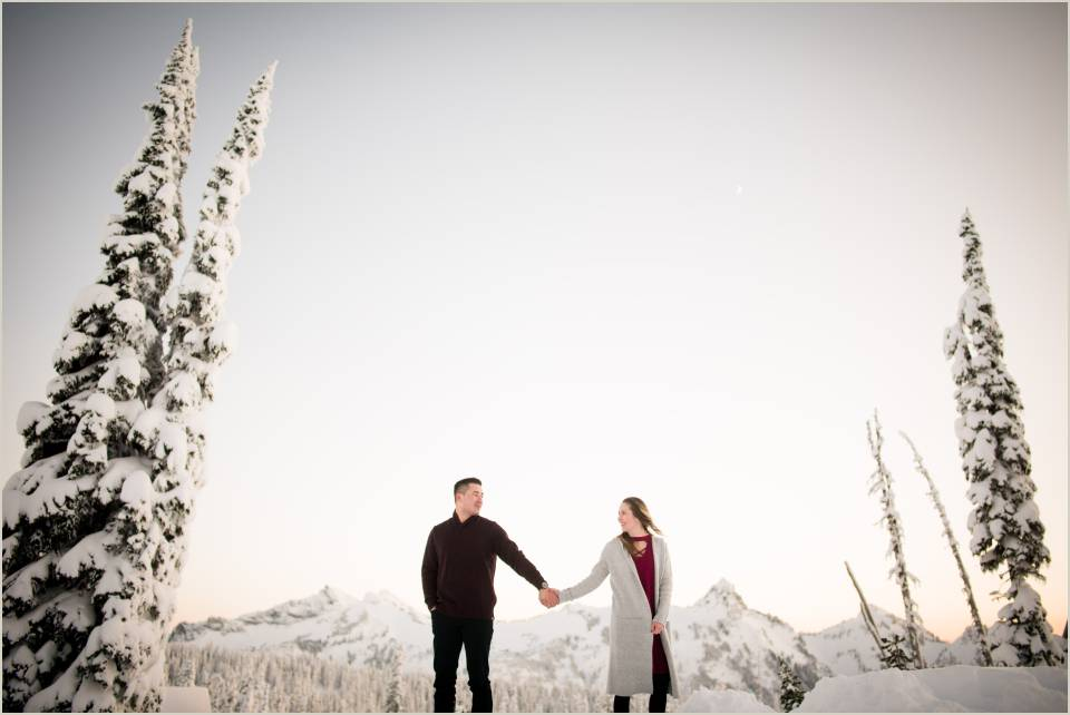 holding hands romantic snow engagement photos mt ranier