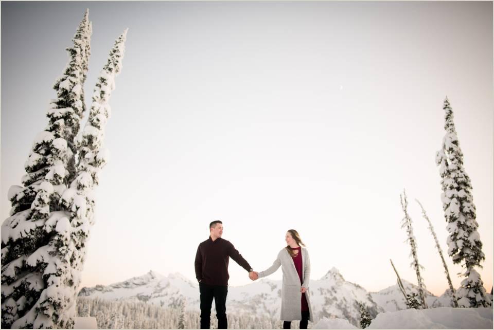 holding hands romantic snow engagement photos mt ranier