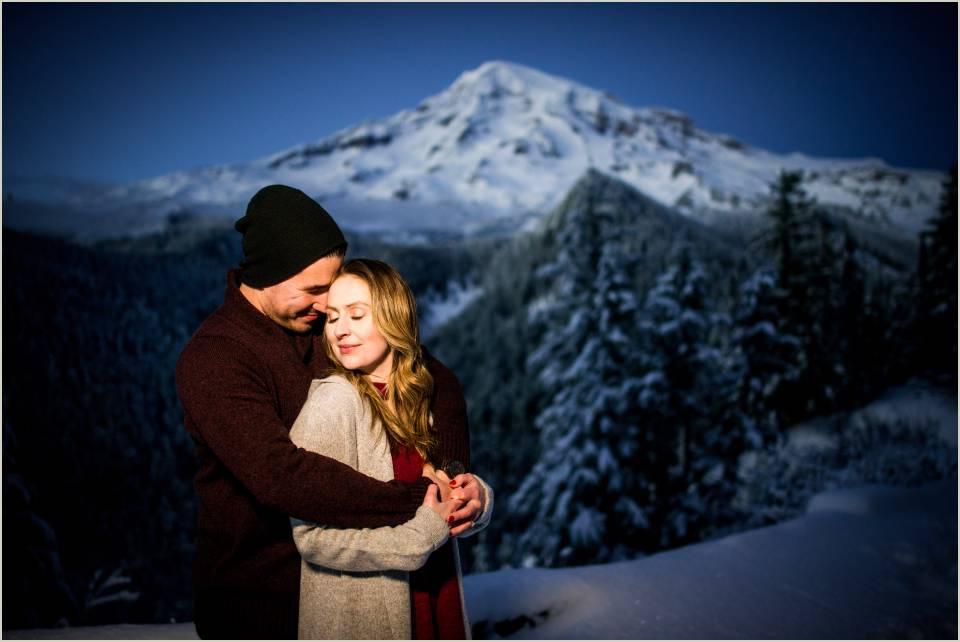 night mt ranier engagement romantic embrace winter wonderland