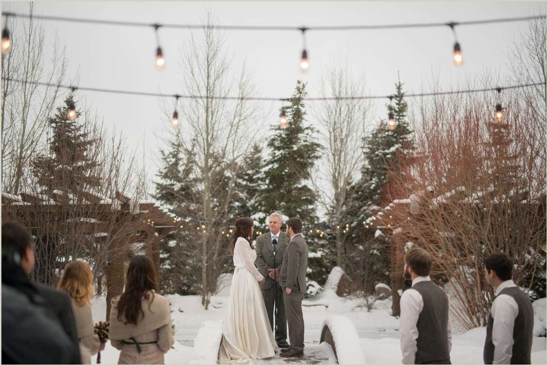 outdoor winter wedding ceremony at bucks t4 ranch