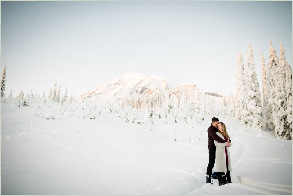 romantic embrace winter engagement mt ranier