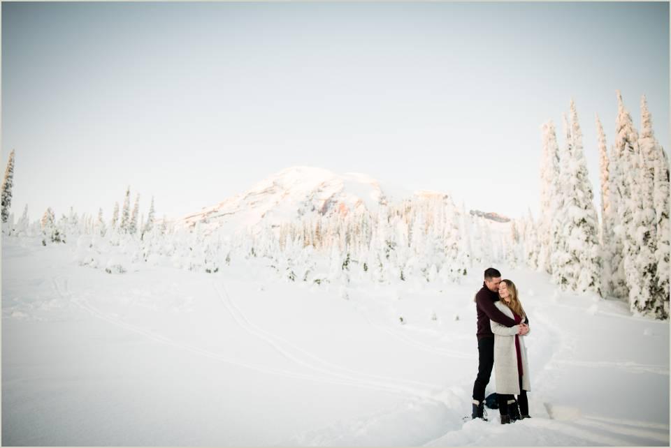 romantic embrace winter engagement mt ranier