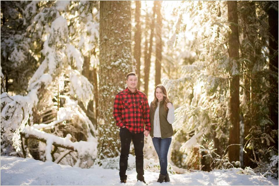 sun through trees warm engagement photos cascades forest