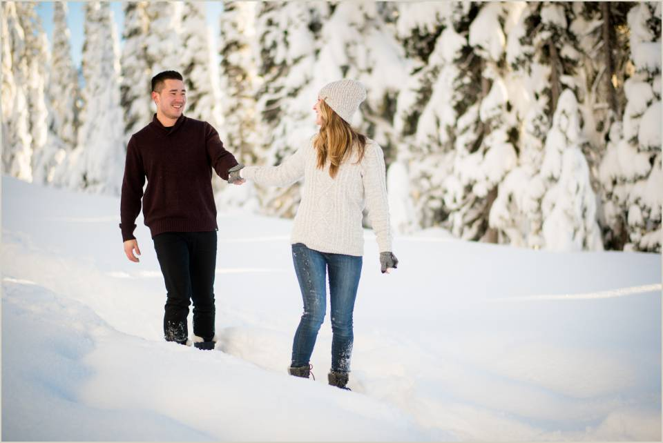 sweather weather snowy engagement photos walking winter wonderland