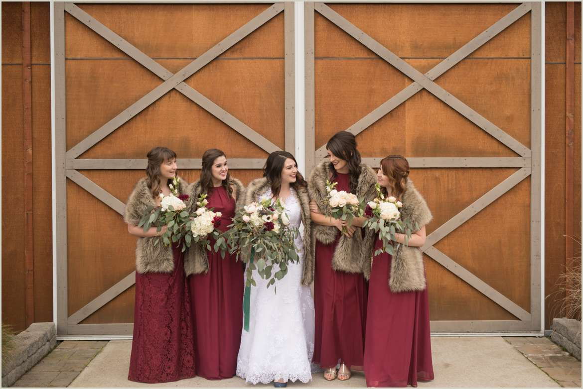 wedding party photos in front of barn