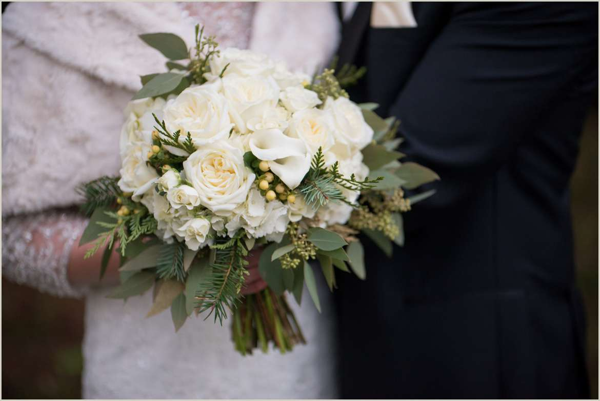 winter wedding flowers with white and greenery 1