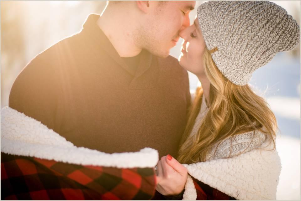 winters warm embrace romantic engagement photos