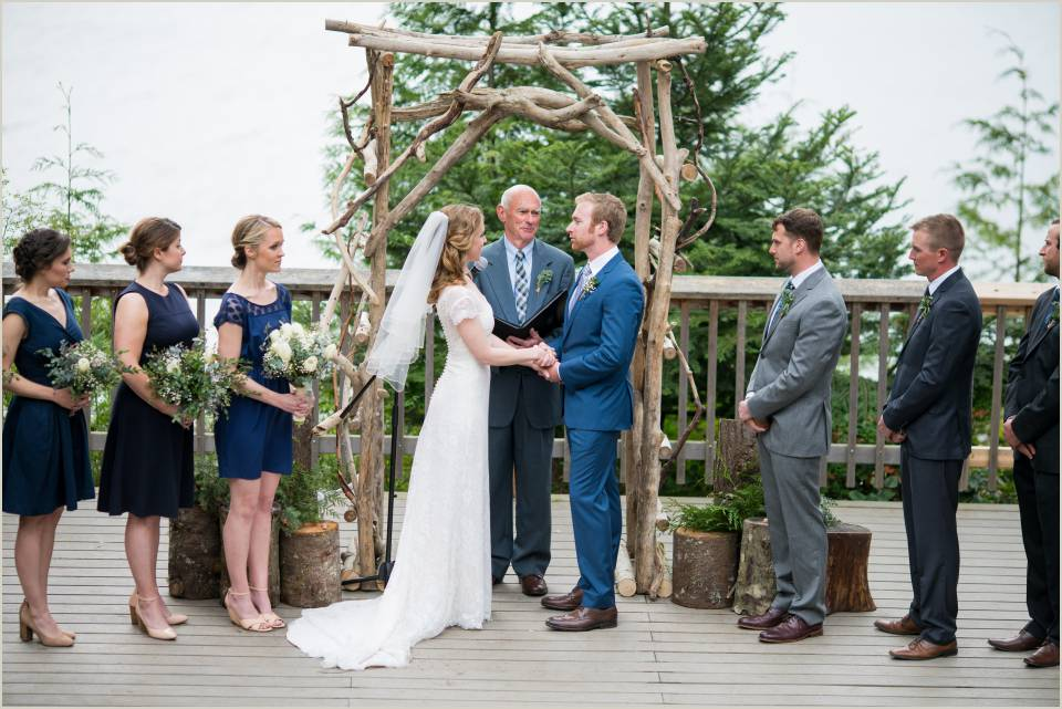 bride and groom say i do at outdoor summer camp wedding