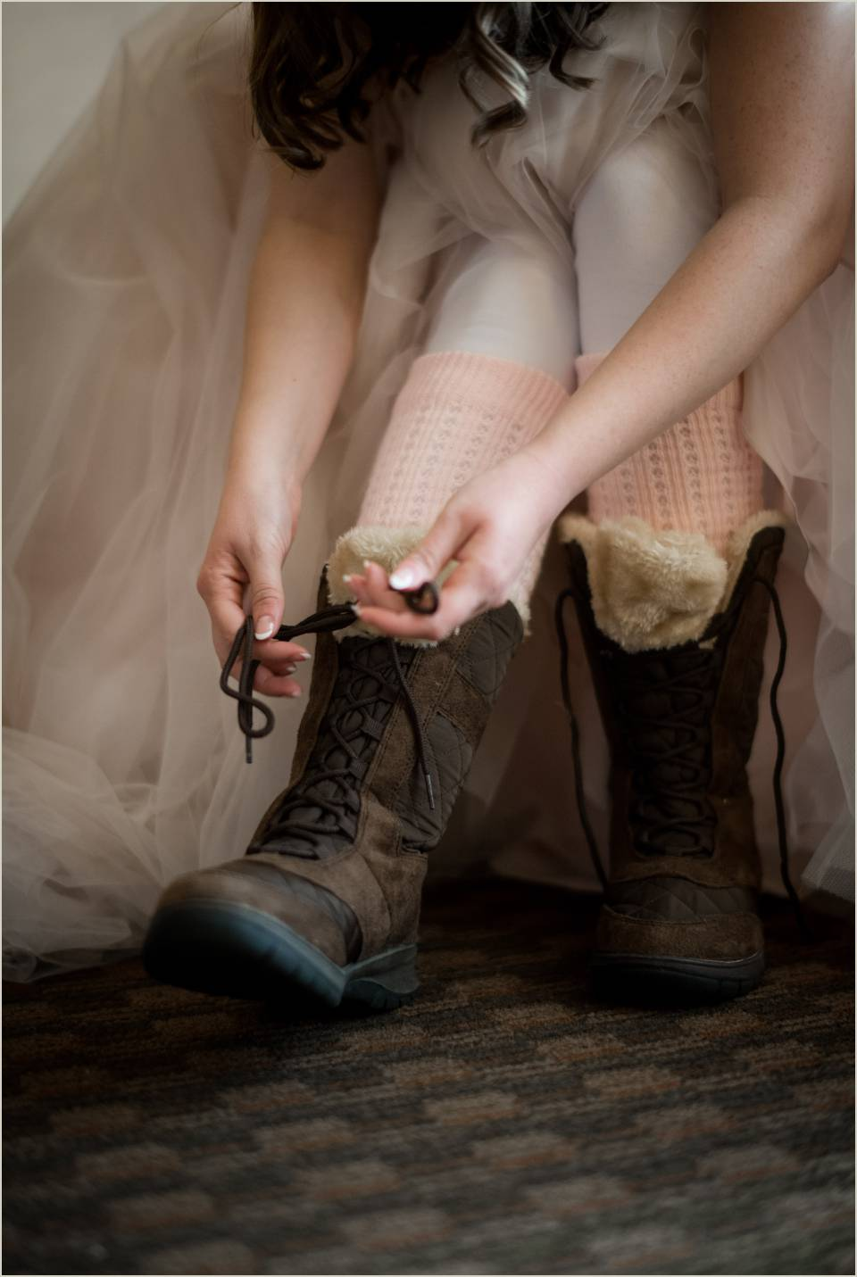 bride lacing up snow boots 1