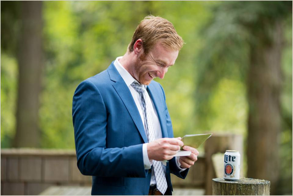 casual groom reading letter from bride