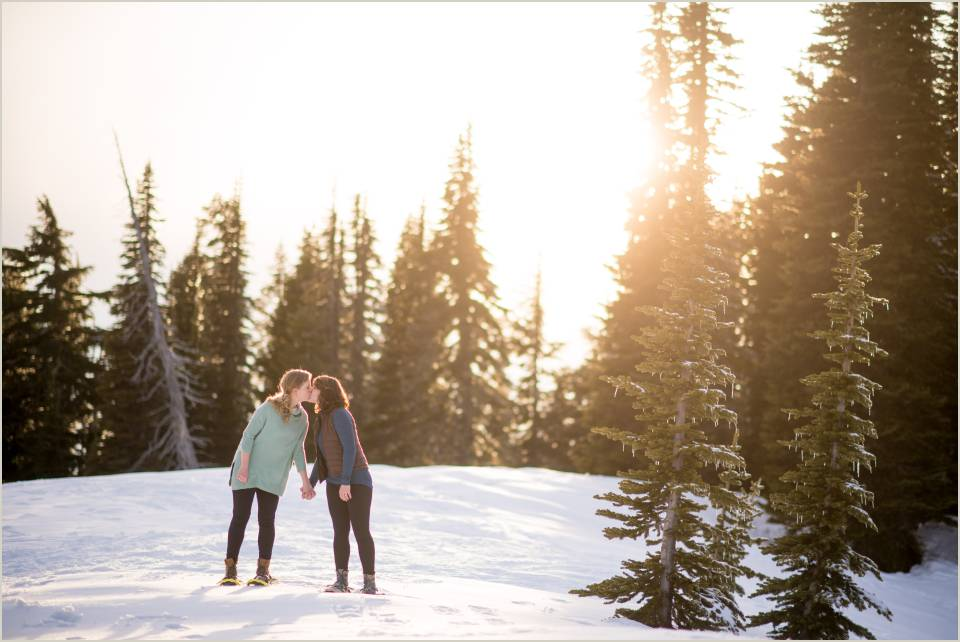 couple kissing in winter sunset