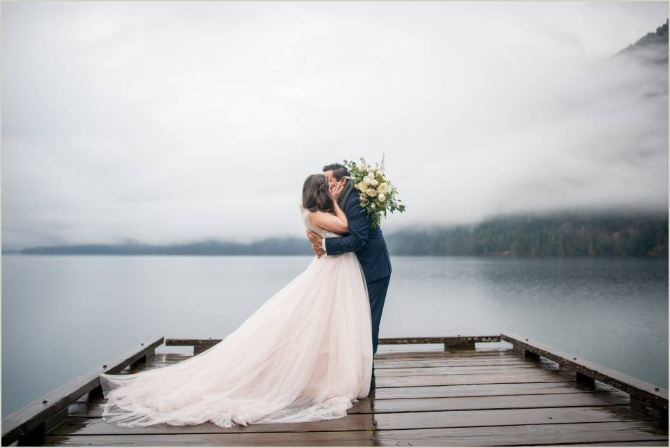 couple kissing on lake crescent pier 1