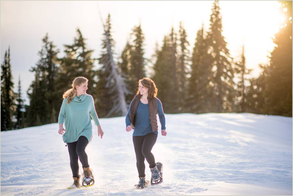 couple running in snow shoes at sunset