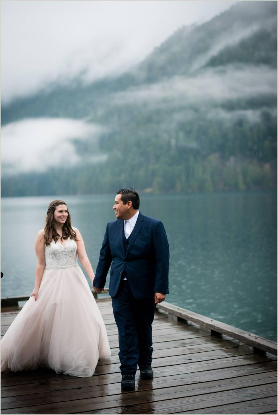 couple walking on dock at lake crescent 1