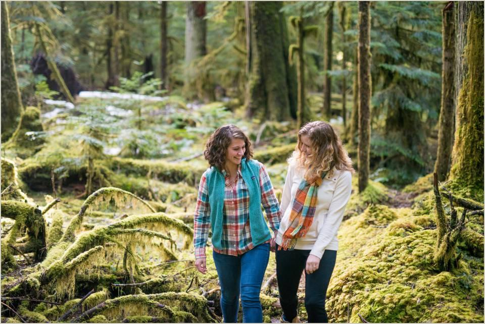 cute couple walking through woods
