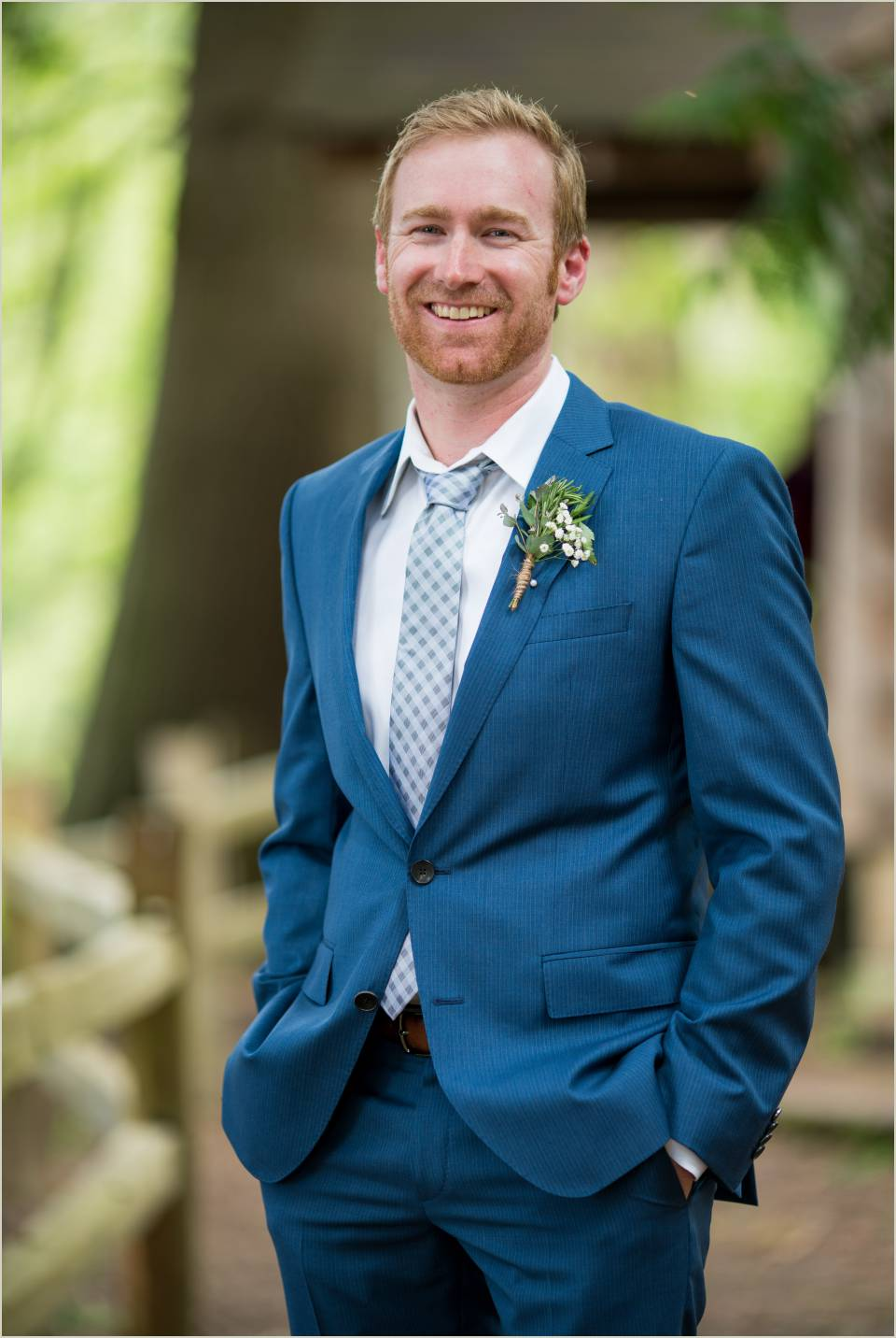 groom in navy suit for outdoor wedding