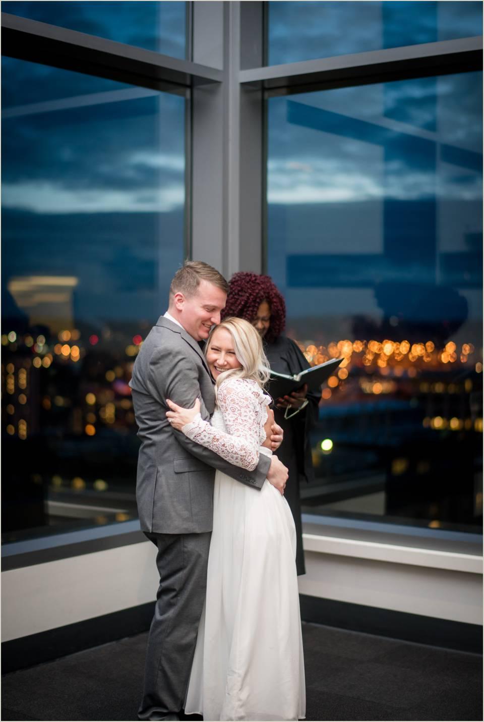 husband and wife couple embracing wedding ceremony