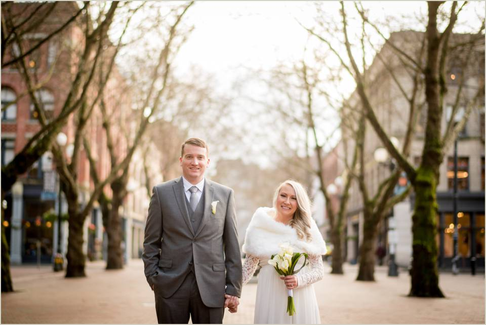 husband and wife wedding photos pioneer square fur wrap