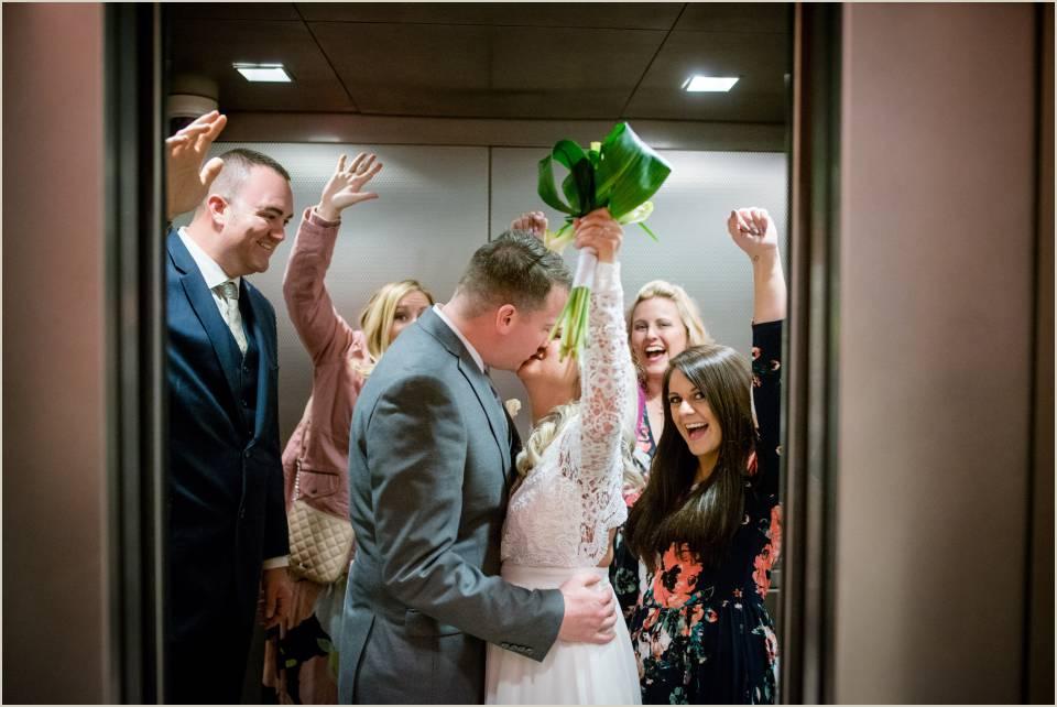 married couple celebrating elevator seattle courthouse wedding