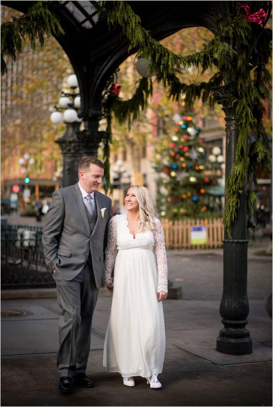 newlywed couple walking christmas wedding photos