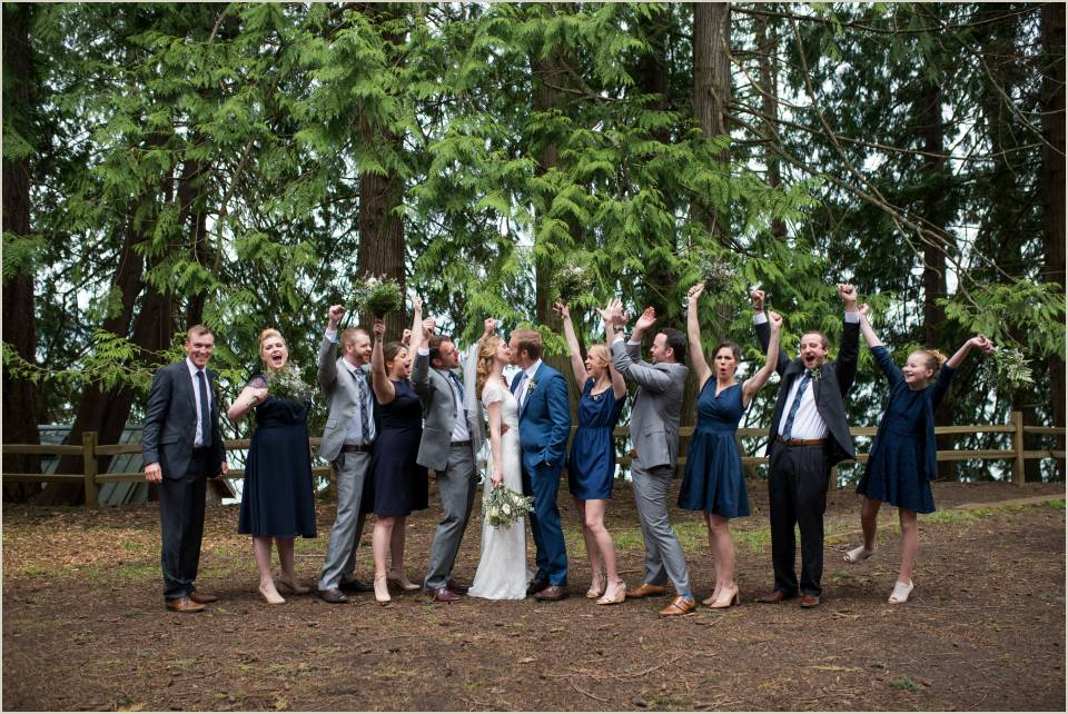 wedding party cheering on couple