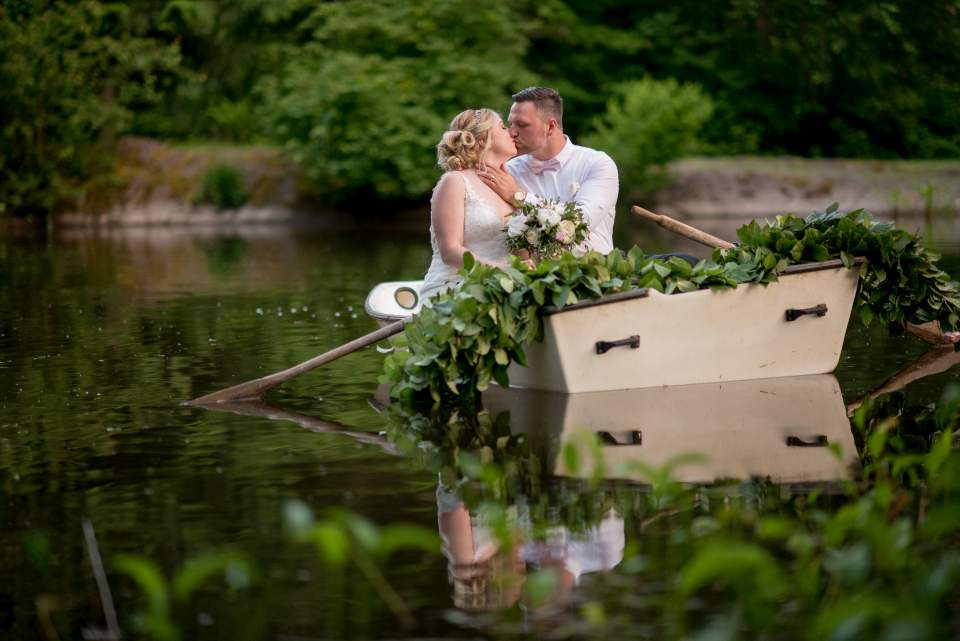 adventurous bride and groom in rowboat