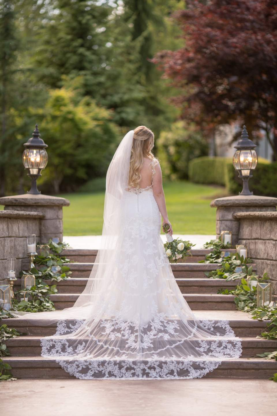 beautiful bridal portrait on steps at rock creek gardens