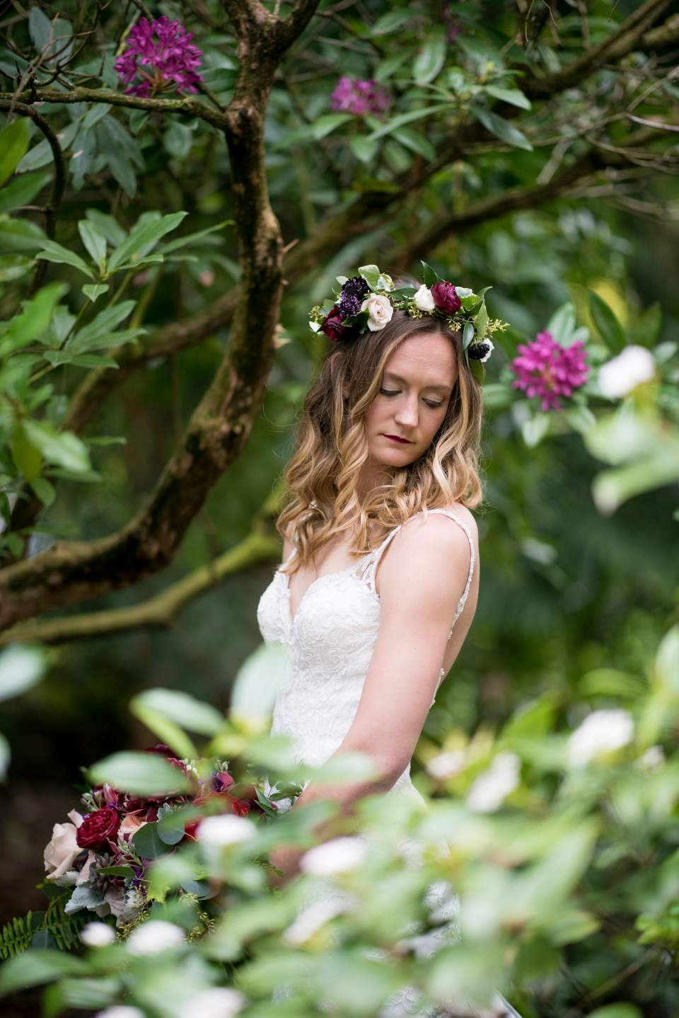 boho bride surrounded by flowers