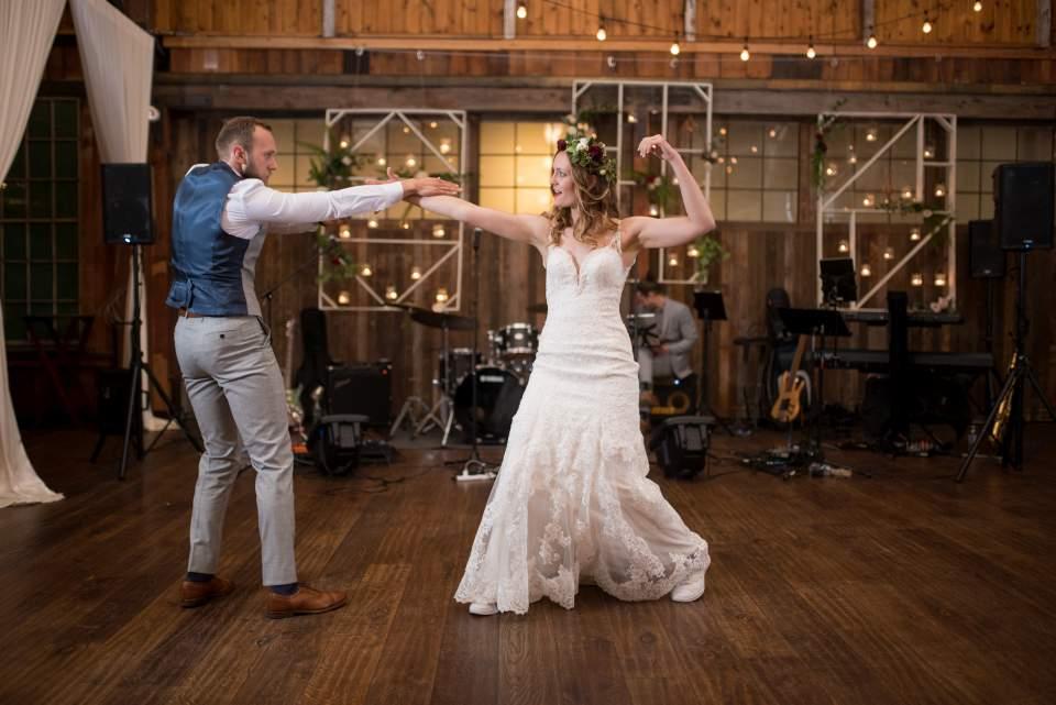 bride and groom dancing together at sodo park wedding