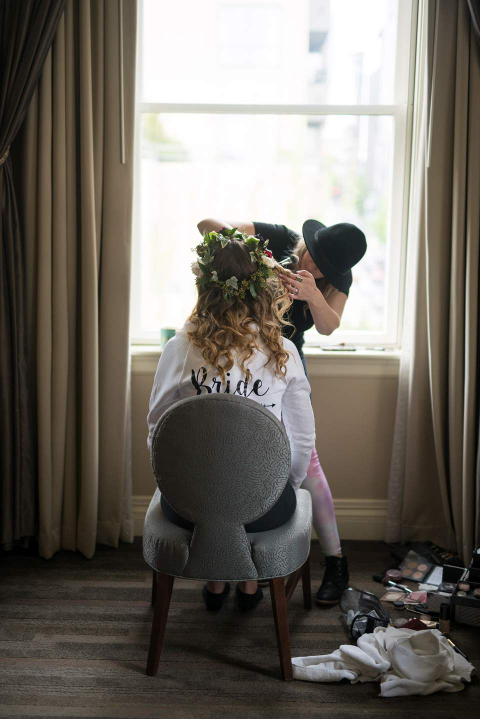 bride getting make up done in seattle hotel
