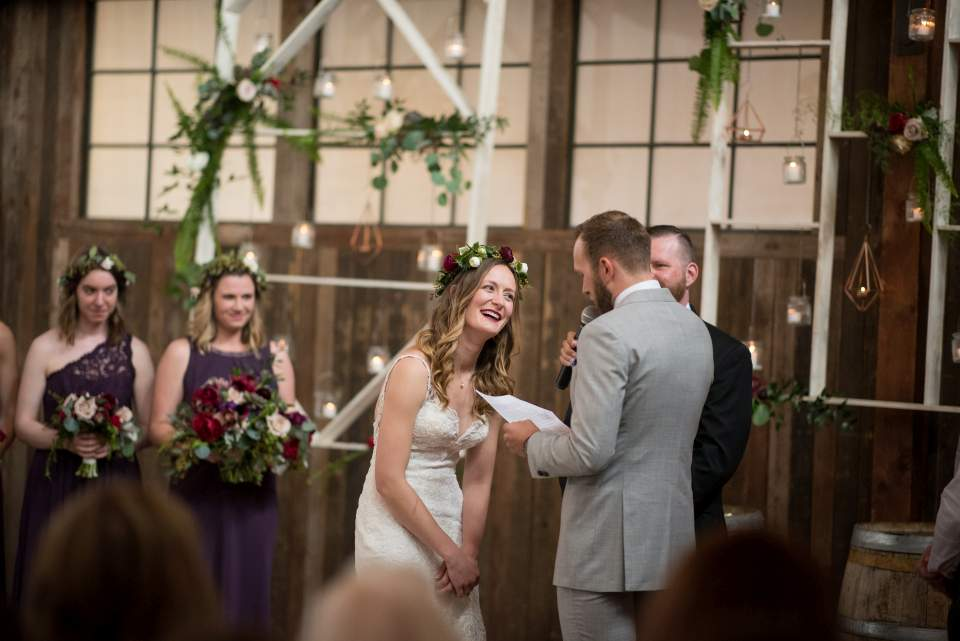bride laughin at grooms wedding vows