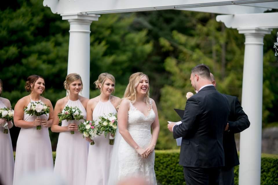 bride listening to grooms hand written vows