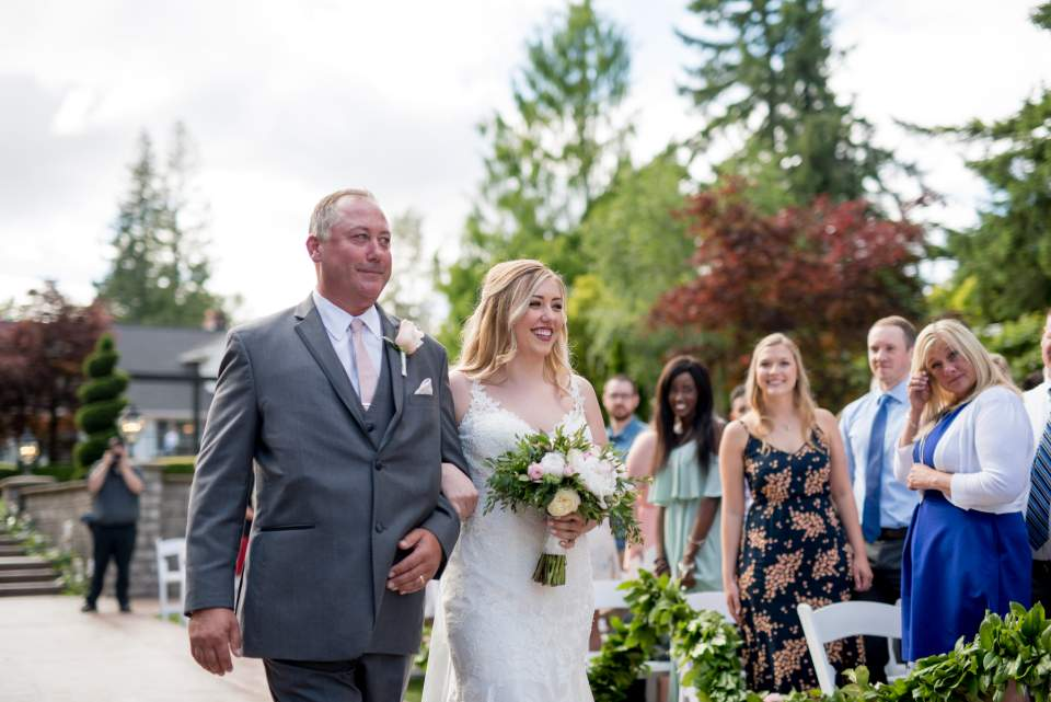 bride walking with her father down the aisle