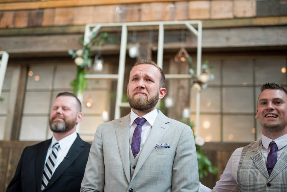 capturing grooms emotional reaction as he watches bride walk down aisle