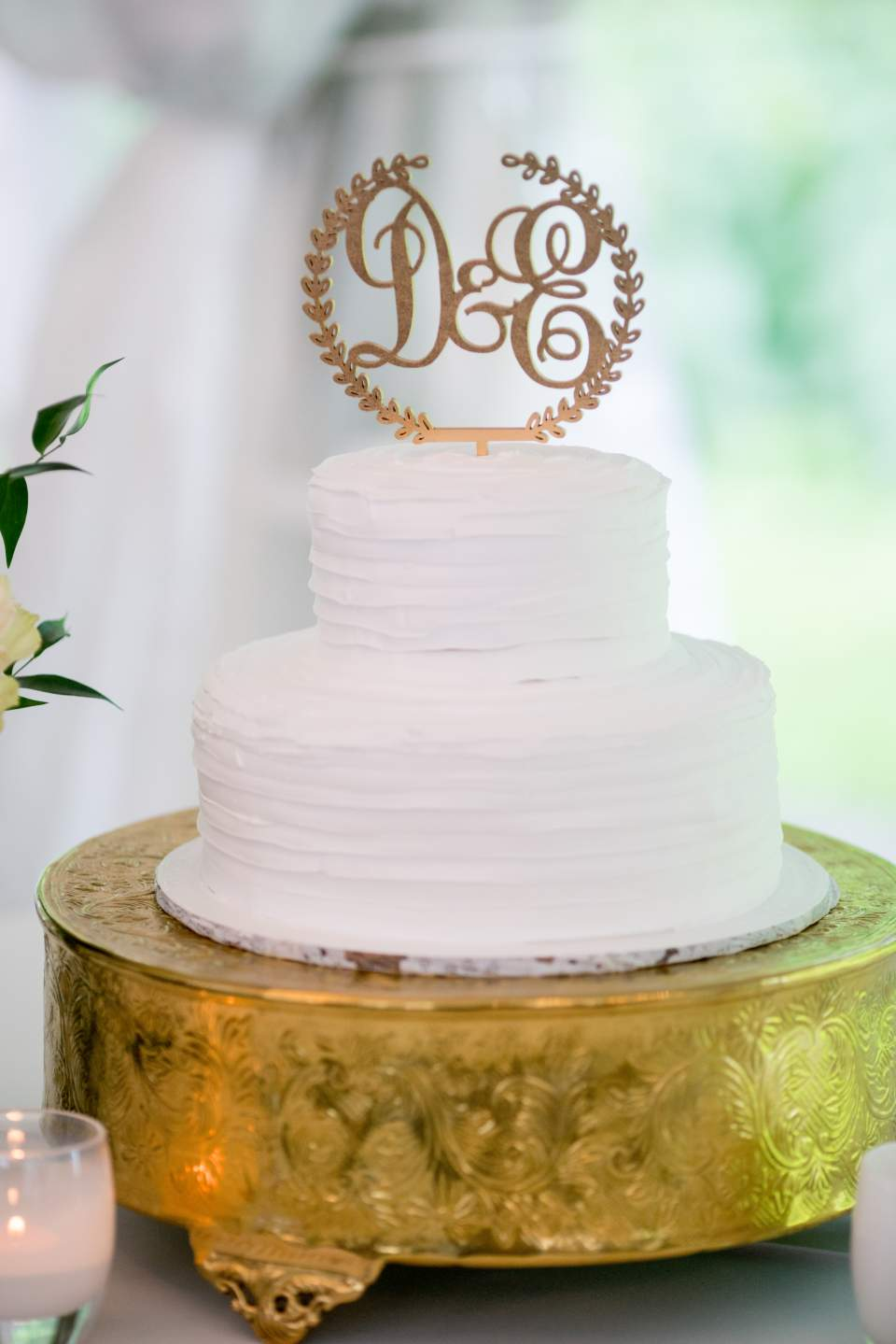 classic white wedding cake with monogram cake topper