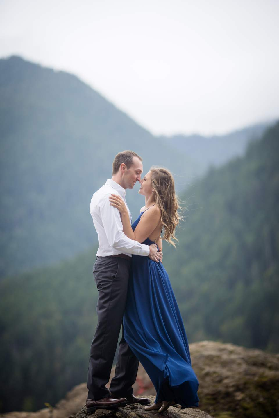 couple standing on a rock at lake cushman