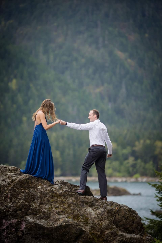 couple walking on rock